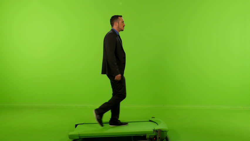Green screen shot of a Buissnesman walking | Shutterstock HD Video #12256931