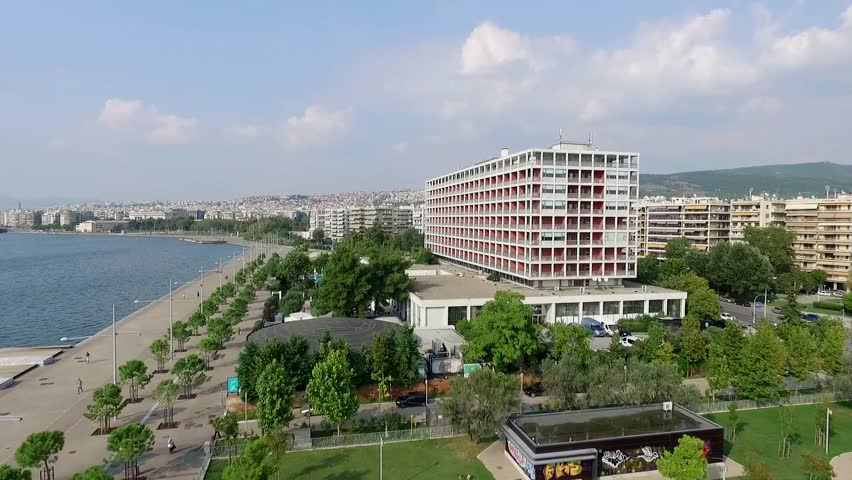 Aerial flying by shot of Thessaloniki city