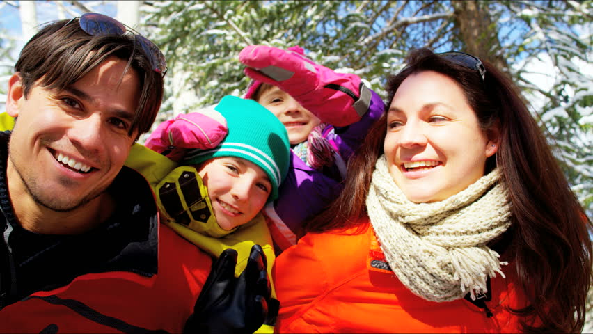 Portrait family waving social media Caucasian male female parents boy girl colorful clothing outdoor snow Aspen ski resort sport travel RED DRAGON | Shutterstock HD Video #12330416