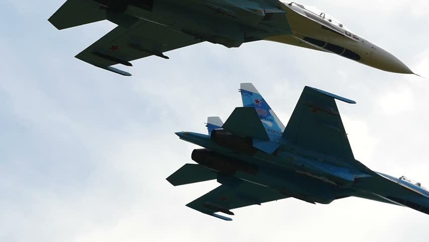 NOVOSIBIRSK, RUSSIA  JULY 26, 2015: Fighter Aircraft Aerobatics Group Close Up Slow Mo