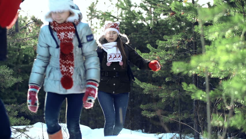 Man leading a winter family hike, his daughter and wife following him   - HD stock video clip