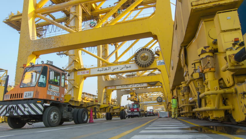 DUBAI - FEBRUARY 28 2013: (TIME-LAPSE) Crane operator and trailer truck working in Dubai Port. February 28, 2013. | Shutterstock HD Video #12371339