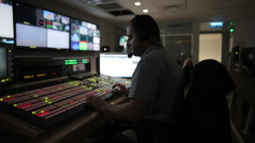 Director broadcast video mixer operation - track left | Shutterstock HD Video #12410237
