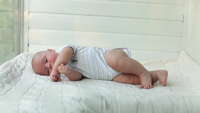 Cute 3 Months Old Baby Lying On His Stomach And Smiles