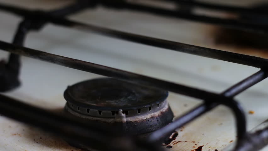 Old Dirty White Gas Stove Which Burns Natural Blue Close Up
