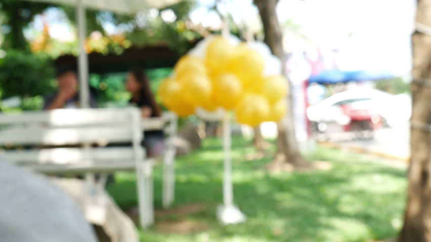 Abstract bokeh and blurred of people talking with Balloons in the Park | Shutterstock HD Video #12462752