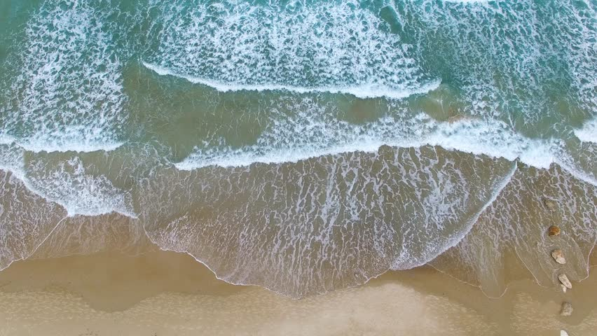 Aerial footage of Tropical Sandy beach with waves breaking on shore | Shutterstock HD Video #12495233