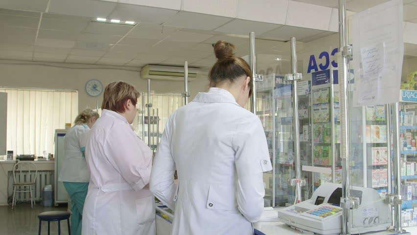 SIMFEROPOL, RUSSIA - CIRCA OCTOBER 2015: Customers buying medicines at russian pharmacy drugstore  | Shutterstock HD Video #12502154