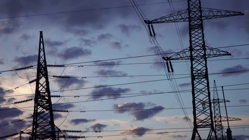 Fast shooting clouds of mast power line at sunset - 4K stock footage clip