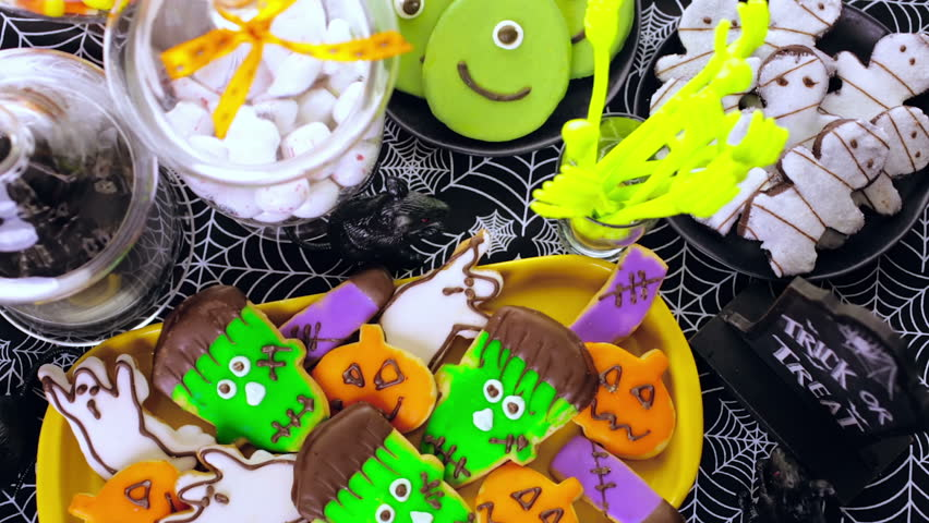 Variety of sweets prepared as Halloween treats. | Shutterstock HD Video #12507815