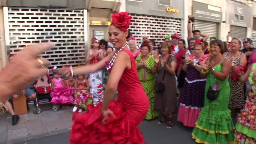 MALAGA, SPAIN - AUGUST, 14: People dancing in flamenco style dress and getting fun at the Malaga August Fair, on August, 14, 2014 in Malaga, Spain - HD stock footage clip