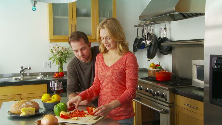 Young couple preparing food in kitchen - HD stock video clip