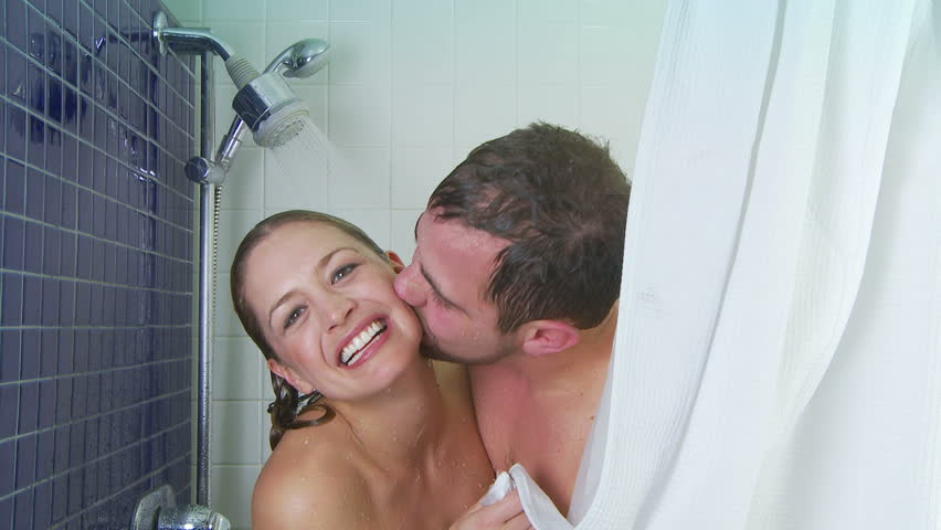 Young couple showering together - HD stock video clip