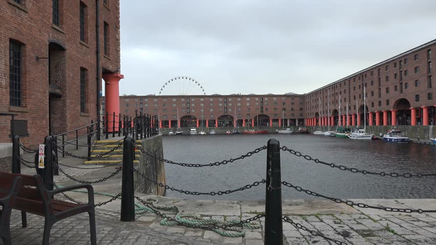 Albert docks in Liverpool, with reflection of Victorian buildings in water