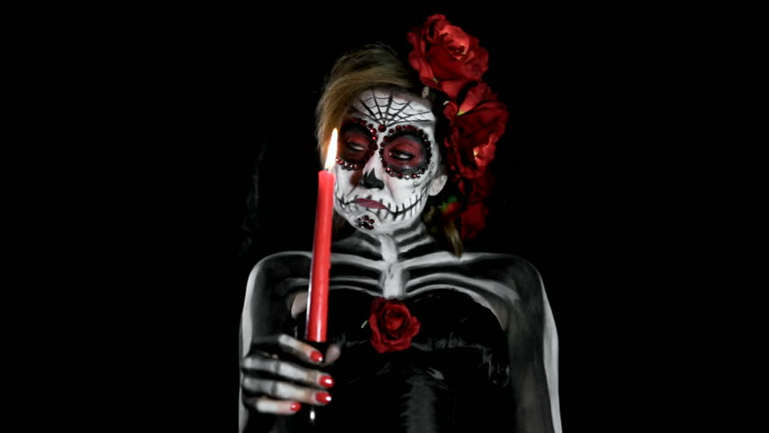 Bored female sugar skull with candle, walking through the room | Shutterstock HD Video #12594188