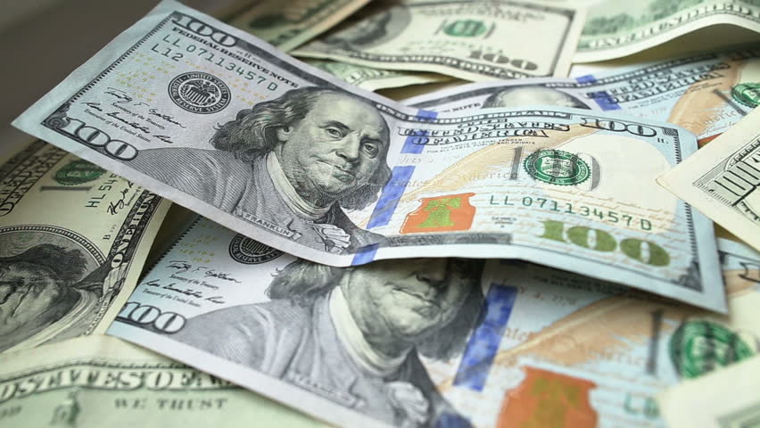 Dollar bills and coins, dolly shot, close up. Full HD - HD stock video clip