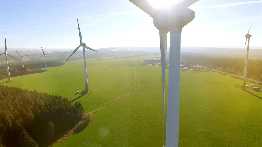 Windmill / Wind power technology - Aerial drone view on Wind Power, Turbine, Windmill, Energy Production - Green technology, a clean and renewable energy solution