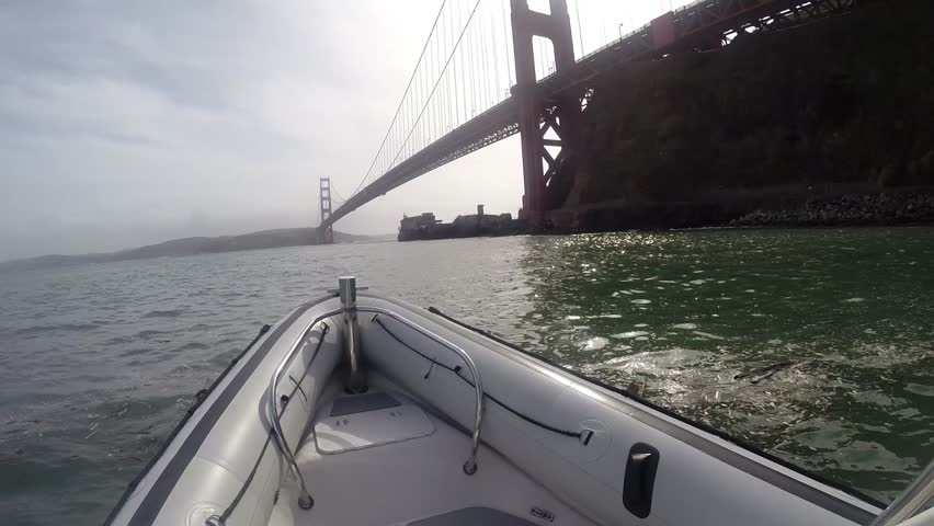 Rigid Hull Inflatable Bow Moving From A Sailboat Marina ...
