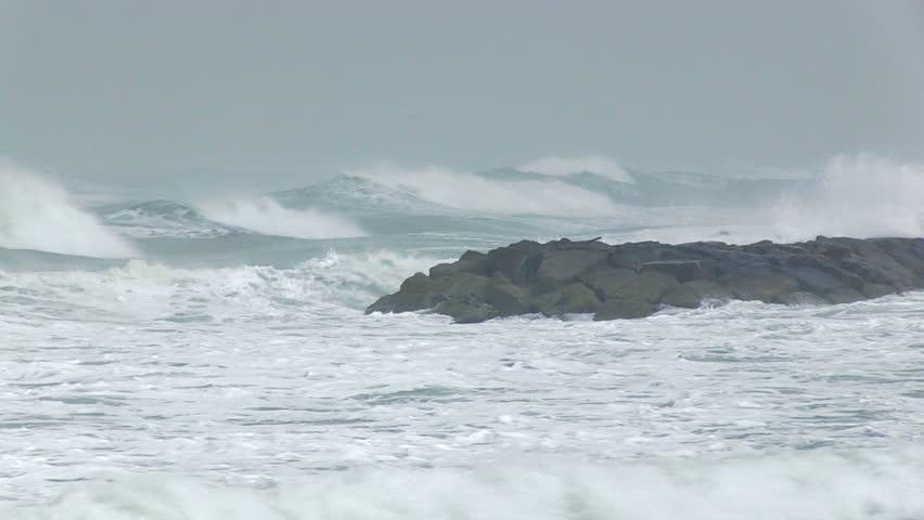 Extreme waves crushing coast.