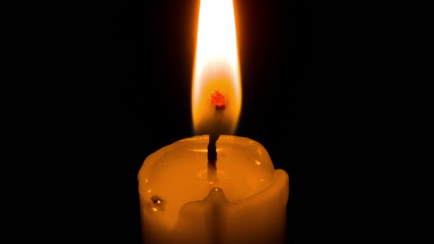 Close up shot of yellow or white taper or dinner candle on black background burning and being lit up. Good clip for birthday videos, different occasions, celebration, holidays like Christmas, New Year | Shutterstock HD Video #12654380