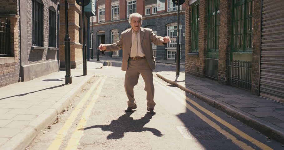 Happy elderly dancer man wearing suit funky street dancing freestyle in the city | Shutterstock HD Video #12658772
