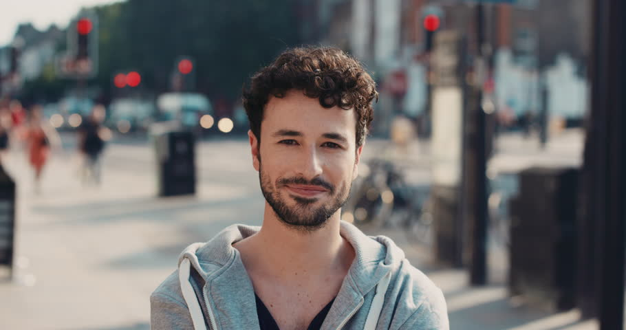 Slow Motion Portrait of happy cute caucasian man smiling in city real people series | Shutterstock HD Video #12665702
