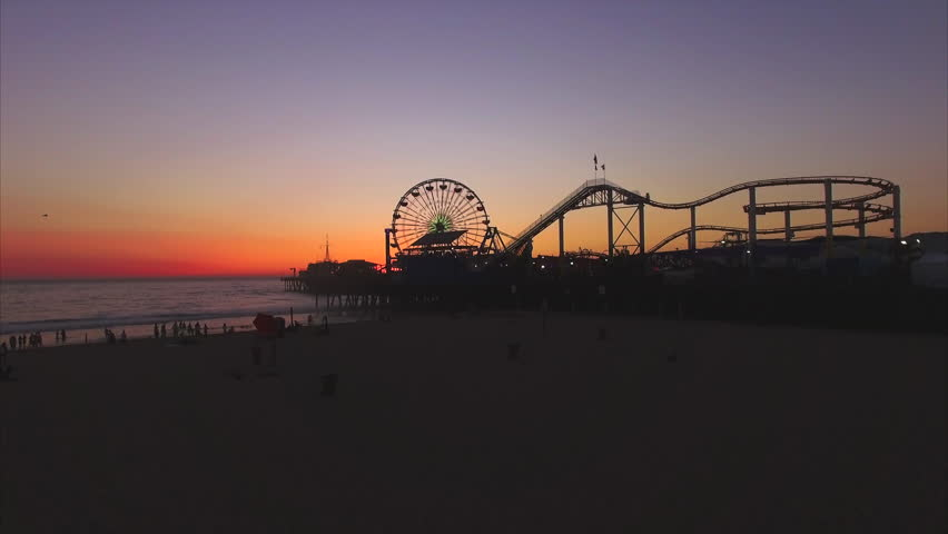 Drone video of Santa Monica Pier against sky during sunset - 4K stock footage clip