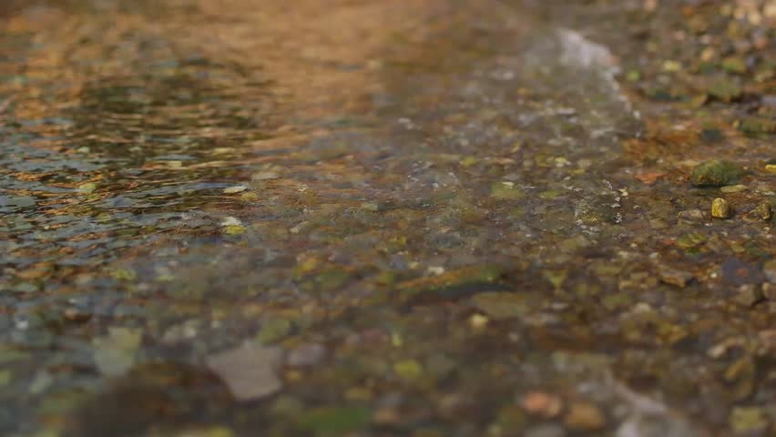Waves splashing the lake Como coast. Water lapping the rocky beach. Reflection in the water. Ripple lake. - HD stock footage clip