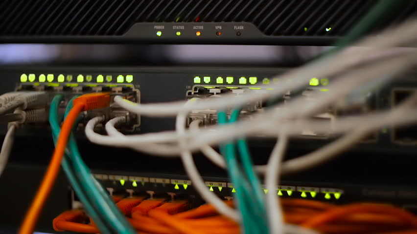 Networ cables in server room. Back panel. Light blinking - HD stock footage clip
