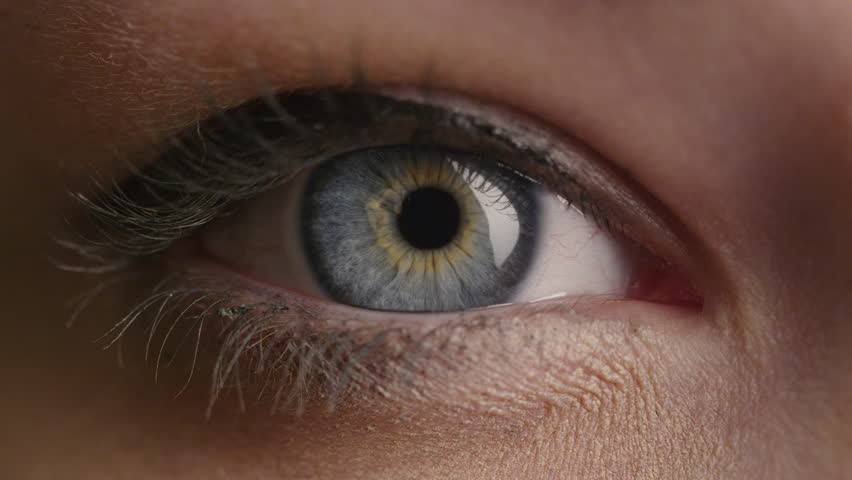 Close-up shot of a woman opening her blue eyes with light day make-up and focusing them. Shot on RED Cinema Camera in 4K (UHD).