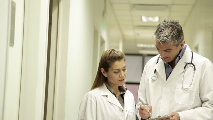 Doctors talking about their patients | Shutterstock HD Video #12723887