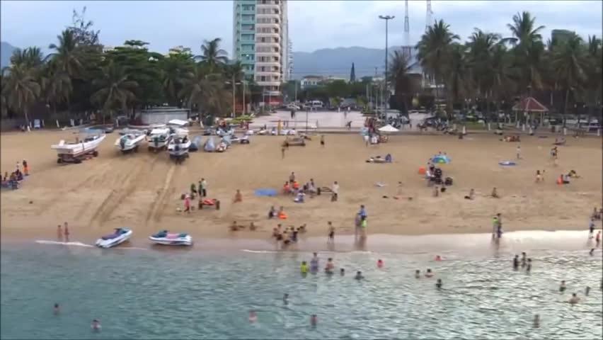 Nha Trang, Vietnam - November 12, 2015: People are swimming on the beach of Nha Trang city - HD stock footage clip