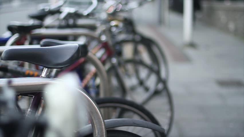 Close up shot, public bicycle parking focus movement - HD stock footage clip
