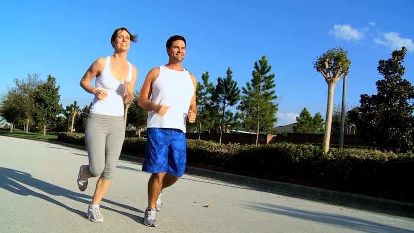 Attractive caucasian couple jogging to keep fit - HD stock footage clip