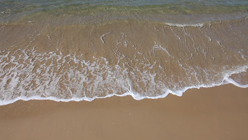 Wave is covering a sea beach sand - HD stock footage clip