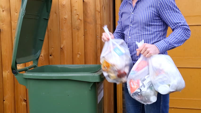Throwing Away Garbage In Public Trash Can Stock Footage