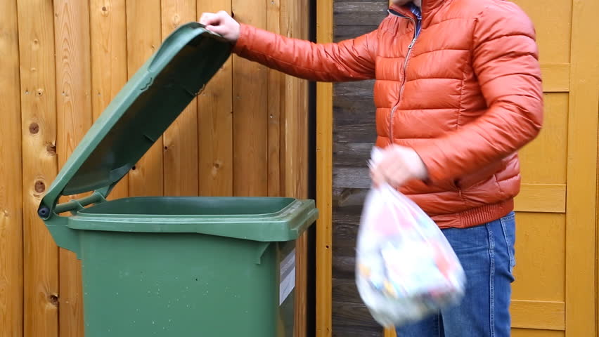 Man Throwing Plastic Into A Recycling Bin Stock Footage
