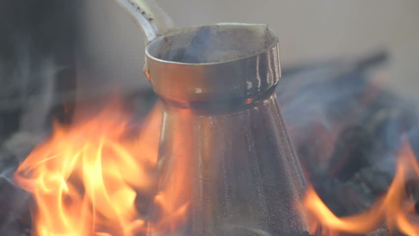 Close-up Of Bronze Coffee Maker Standing On Fire Stock Footage Video 1278778 - Shutterstock