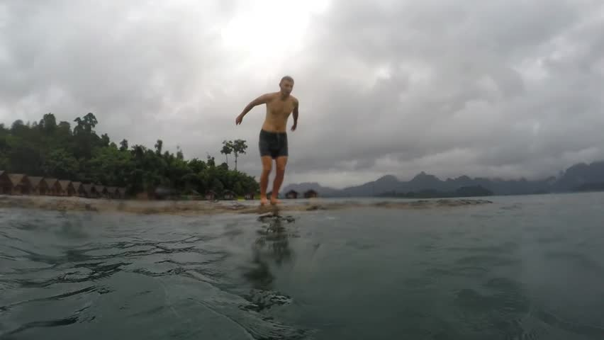Young Man Jumping into Water. Slow Motion. HD, 1920x1080. | Shutterstock HD Video #12808136