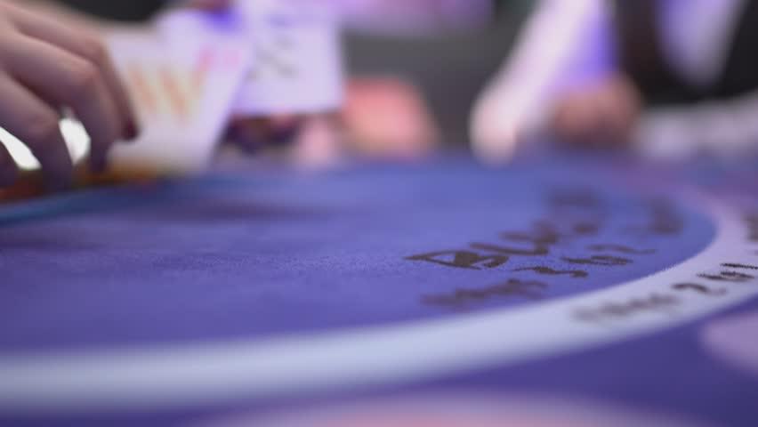 Gambling Black Jack in a casino - dealer spreading cards on a black jack table | Shutterstock HD Video #12838376