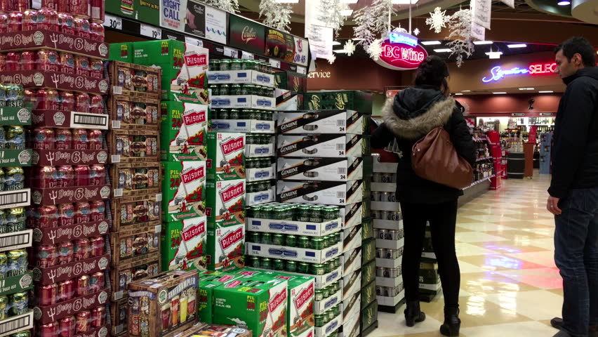 Coquitlam, BC, Canada - November 20, 2015 : Couple buying colt45 beer inside BC liquor store with 4k resolution