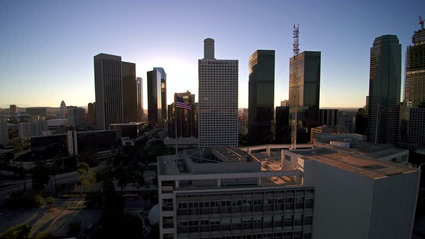 Aerial view of Downtown Los Angeles and American Flag Waving. 4K UHD | Shutterstock HD Video #12917126