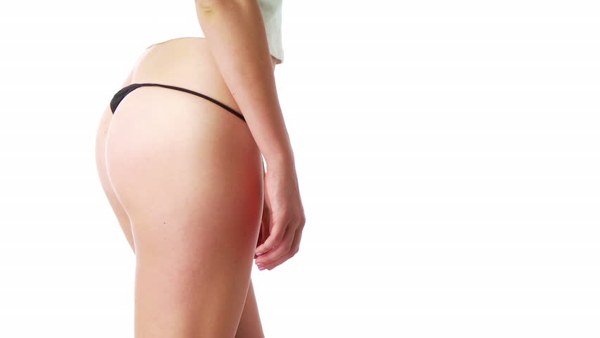 Young woman in sexy black underwear pulling up jeans