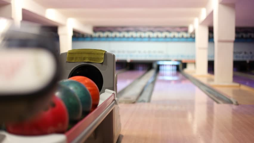 Man throw ball and hit all pins - strike in bowling club