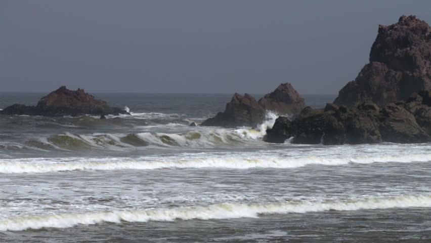 Beautiful Atlantic Ocean waves rocky point on the beach. Atlantic Ocean waves. Blue water and waves crashing along beach and rocks. - HD stock video clip