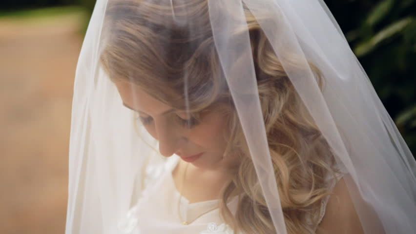 Bride Wears A Veil At Face Close Up - HD stock footage clip
