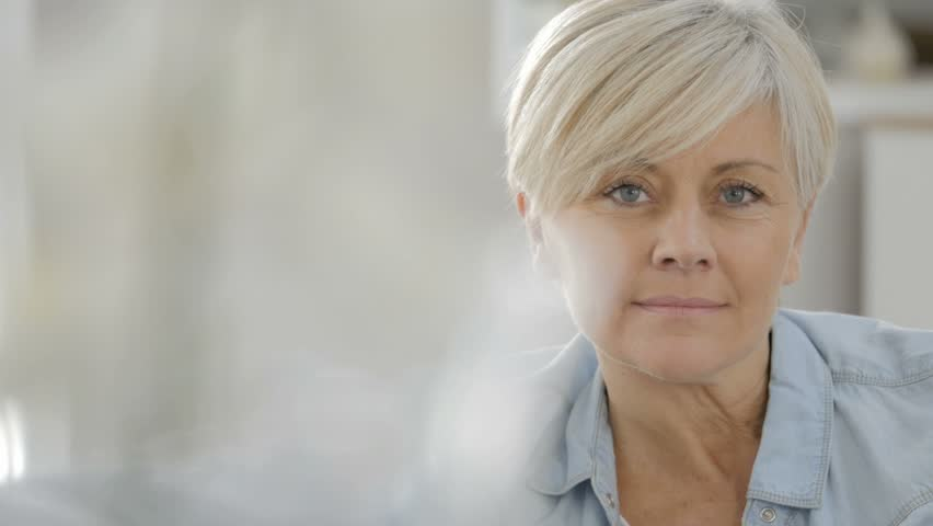Portrait of senior woman looking at camera - HD stock footage clip