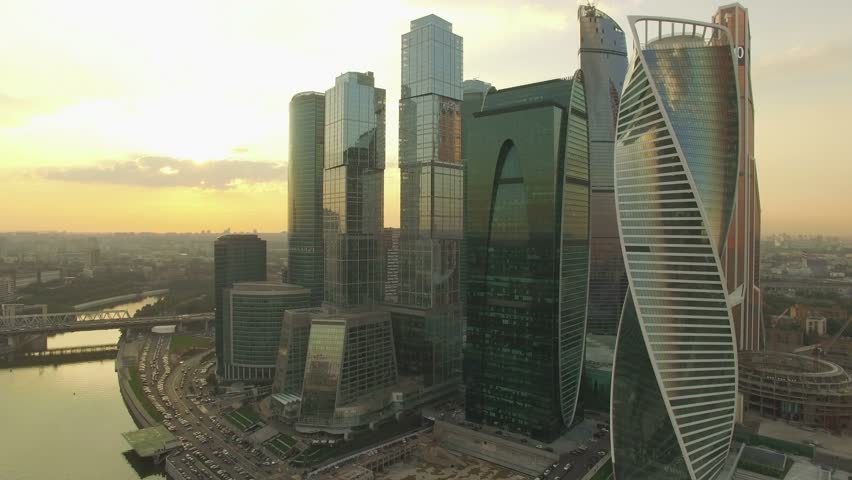 Aerial real time sunset video of Moscow International Business centre. The camera is approaching to the skyscrapers. The concept of business success. 4K, Ultra HD video, DJI Phantom 3 pro. | Shutterstock HD Video #13006766