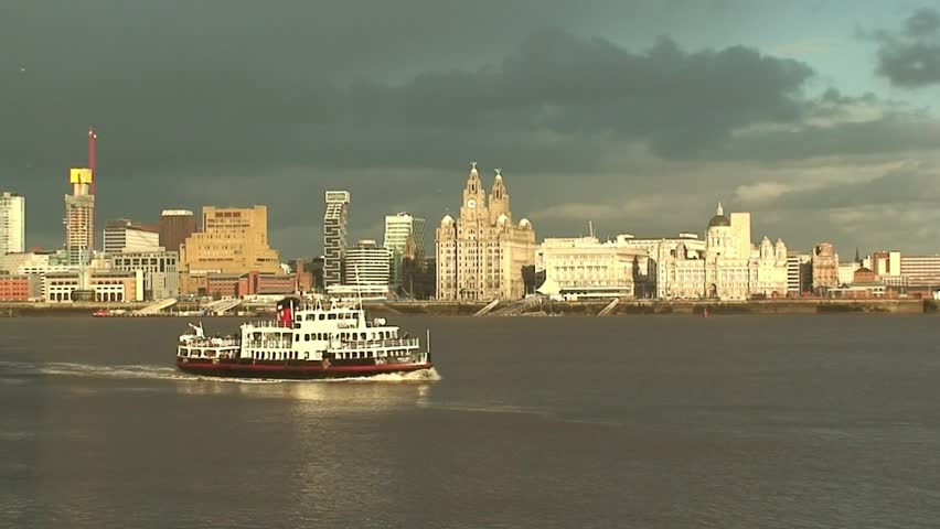 Liverpool's historic waterfront with the mersey ferry passing