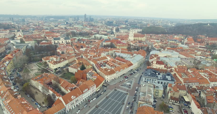 AERIAL. Smooth flight up above Town Hall Square of Vilnius old town